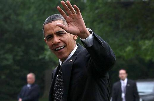US President Barack Obama waves as he arrives at the White House after his trip to Afghanistan. Photo: Getty Images