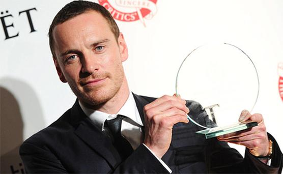 Michael Fassbender with his award for 'Best British Actor'