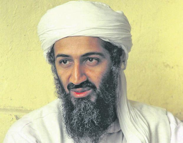 Osama bin Laden...FILE - In this April 1998 file photo, exiled al Qaida leader Osama bin Laden looks on in Afghanistan. For a man on the run, Osama bin laden seemed to do very little running. Instead, he chose to spend long stretches _ possibly years _ in one place and often in the company of his family. (AP Photo/File) ...I