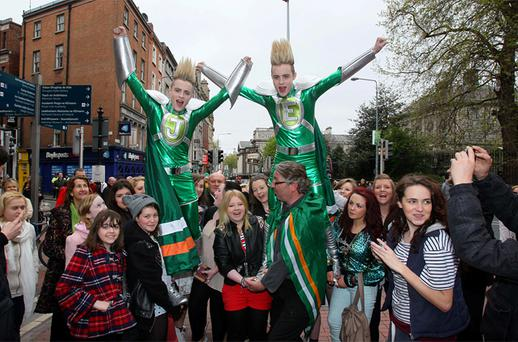 Jedward with DJ Colm Hayes and fans on Grafton Street, Dublin, yesterday where they launched Jedward's Euro 2012 'Put the Green Cape On' single for charity