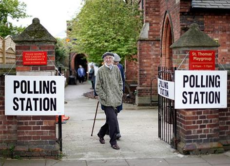 People leave after casting votes at St Thomas' Church Hall in Highbury, London, yesterday. Photo: Getty Images