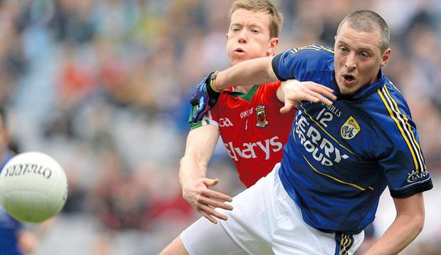 Kieran Donaghy battles for possession with Mayo's Donal Vaughan.