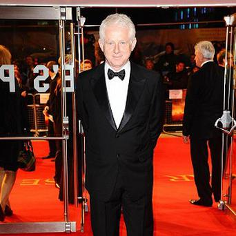 Richard Curtis says awards juries aren't keen on romantic comedies