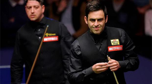 Ronnie O'Sullivan and Matthew Stevens during their semi final match. Photo: PA