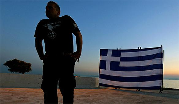 A member of the extreme right Golden Dawn during an election campaign rally in Athens