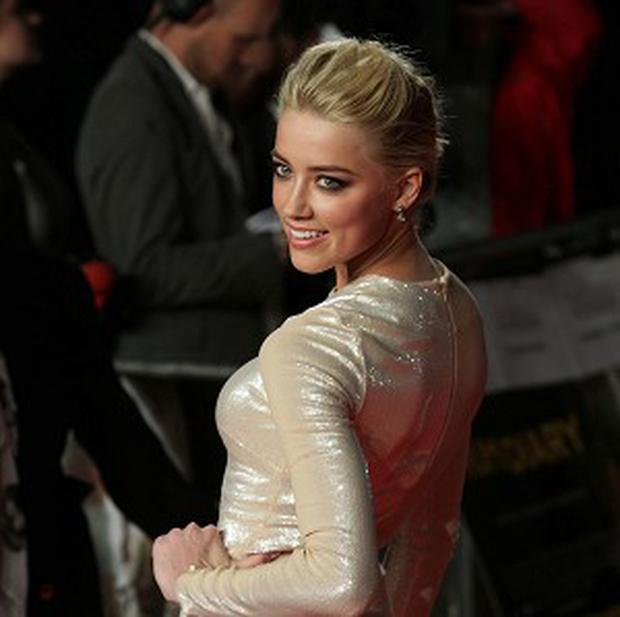 Amber Heard is tipped for a role in Machete Kills