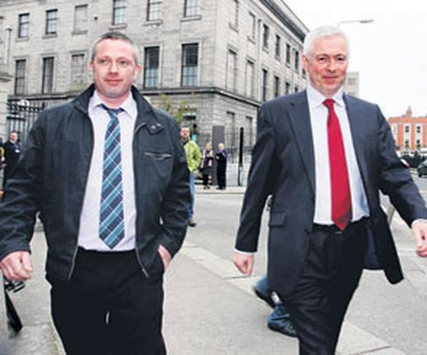 Ronan MacConnoran (left) and his solicitor Dave Coleman leave court yesterday