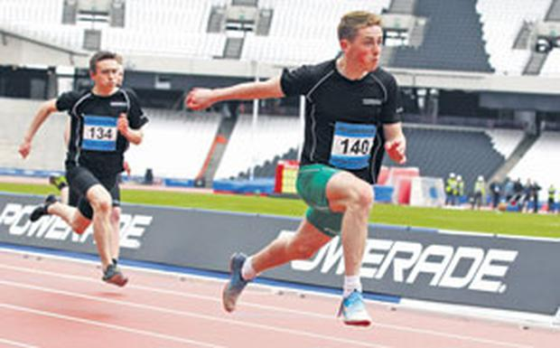 Evan Maguire powers ahead in his winning sprint at London's new Olympic stadium.