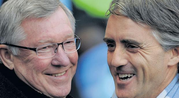 Alex Ferguson and Roberto Mancini share a joke before last Monday's Manchester derby