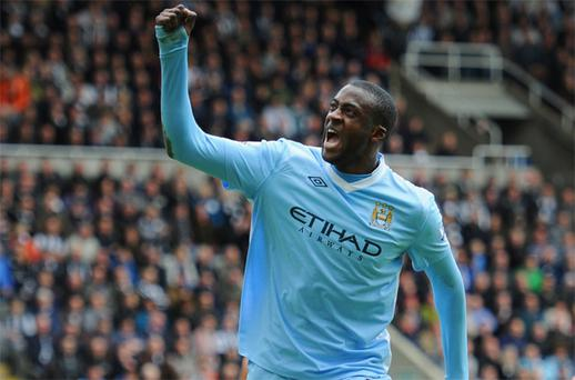 Yaya Toure celebrates after scoring Manchester City's second goal against Newcastle