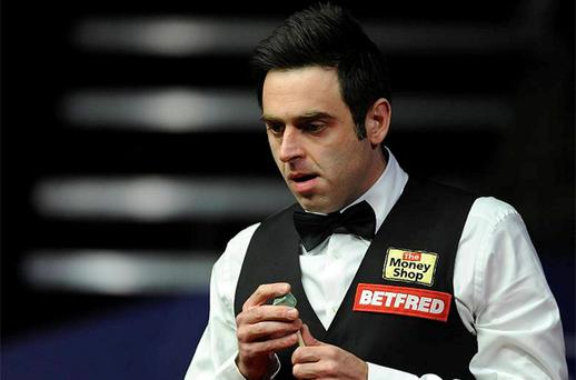 Ronnie O'Sullivan studies the table during the final of the Betfred.com World Snooker Championships at the Crucible Theatre, Sheffield. Photo: PA