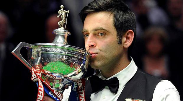 Ronnie O'Sullivan celebrates his victory with the trophy. Photo: PA