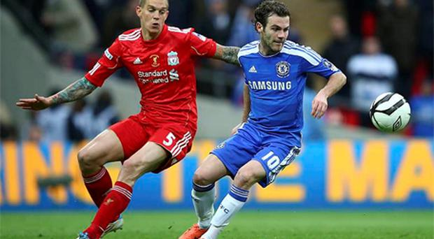 Daniel Agger of Liverpool and Juan Mata of Chelsea battle for the ball during the FA Cup final. Photo: Getty Images