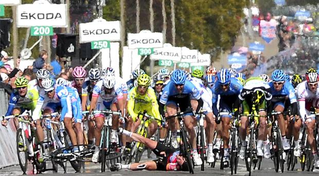 Mark Cavendish suffers a crashing fall during the third stage of the Giro d'Italia in Horsens, Denmark, yesterday