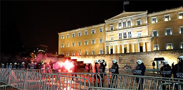 Riot police on guard outside the Greek parliament in Athens during riots last February. Photo: Getty Images
