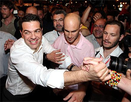 Head of Greece's Left Coalition party Alexis Tsipras celebrates with supporters in Athens