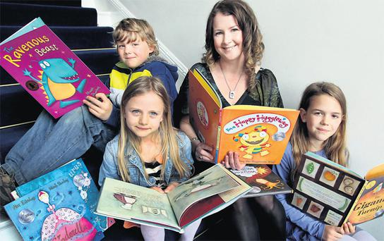 Author and illustrator Niamh Sharkey who was presented with the Laureate na nOg, or laureate for children's literature, medal at a special event in Dublin yesterday with children George Lawrenson (8), Cara Thornton (7) and Anika Solomon (9).