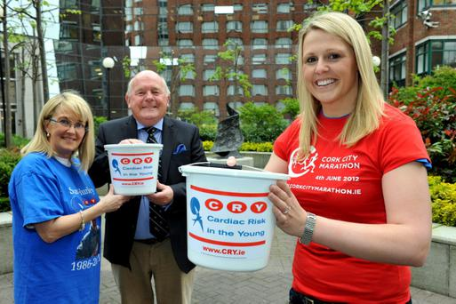 NO FEE FOR REPRODUCTION:BITTERSWEET MARATHON PLANNED FOR RTÉ BROADCASTERFriends and family to join RTÉ broadcaster Jacqui Hurley in running the Cork City Marathon relay in memory of her brother.Pictured today (08.05.12) Michael Greene, Chairman of Irish Charity CRY with RTÉ broadcaster Jacqui Hurley (right) and Lucia Ebbs, who are part of a special Cork City Marathon relay team who are taking part in this year's Cork City Marathon as part of a bucket list in memory of Jacqui's younger brother, Sean Hurley, who died tragically in a car crash last November. Just two days before he died, Sean had prepared just a bucket list of things he would like to do before he died. Now Jacqui, together with family and friends, have undertaken to complete all of Sean's goals and ambitions - including competing in the Cork City Marathon. All money raised in the process will be donated to the Irish charity CRY, of which Jacqui is an ambassador, raises awareness and offers support to those affected by sudden cardiac death, and funds the activities including free screening at the Centre for Cardiac Risk in Younger Persons (CRYP) in Tallaght Hospital. If you would like to support Jacqui at this years Cork City Marathon, search for Seans Bucket List in the Donate Now section of the www.cry.ie website.Cork City Marathon takes place this June Bank Holiday Monday, June 4, 2012. For registration details, training tips and more see www.corkcitymarathon.ie.Media info: Nuala Ryan - H+A Marketing + PR - Emmet House, Barrack Square, Ballincollig, Corknryan@hagroup.ie   www.hagroup.ie   +353 21 4 666 200   083 421 2733Pic. Maura Hickey.