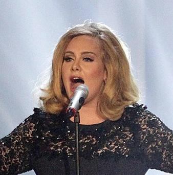 Adele fans splashed out an estimates thirty-six million pounds on tickets and merchandise last year, a poll found