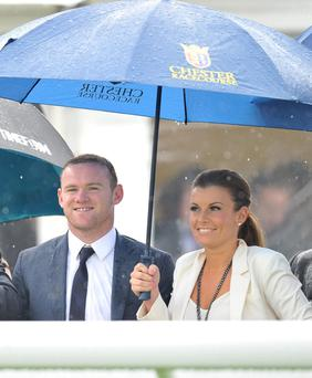 Wayne and Coleen Rooney watch The Manor House Stables Lily Agnes Conditions Stakes at Chester Races during the Stan James Cup Day during the May Festival at Chester Racecourse, Chester. PRESS ASSOCIATION Photo. Picture date: Wednesday May 9, 2012. Photo credit should read: Martin Rickett/PA Wire