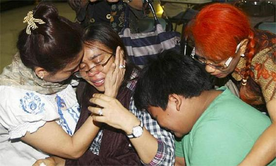 Relatives weep as they wait for the news on a missing Russian airplane at Halim Perdanakusumah airport in Jakarta, Indonesia. Photo: Associated Press