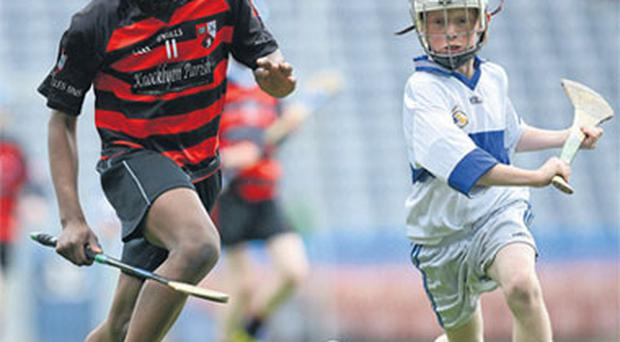 Christian Tshibangu (St Colmcille's NS Knockyon) in action against Sean Lambe (Scoil Mhuire Marino) in the final of the Cumann na mBunscoil Corn Herald at Croke Park yesterday.