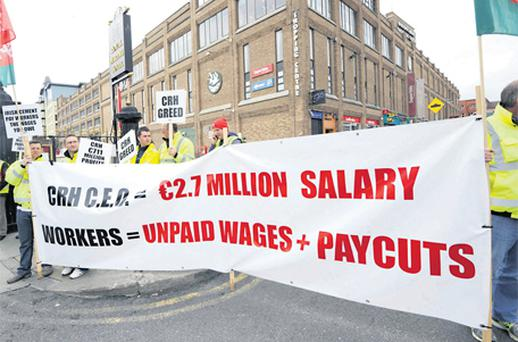 Irish Cement workers protest outside CRH's annual general meeting in the Royal Marine Hotel in Dun Laoghaire yesterday over a pay dispute
