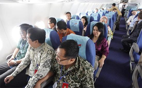 Passengers pictured on the doomed jet just before take-off