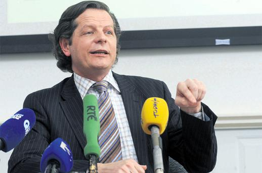 Secretary General of the Department of Finance John Moran hosts a press conference yesterday