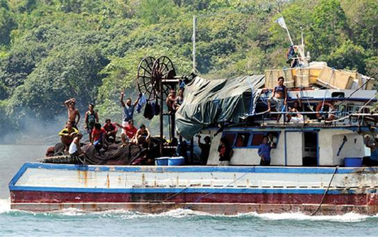Filipino fishermen sail off from the port of Masinloc town, Zambales province, north of Manila for a fishing expedition near Scarborough Shoal. Photo: Getty Images
