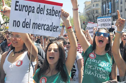 Students protest against cuts in the public education system in Madrid yesterday. Banners read 'Europe of knowledge, not of the merchant' and 'More education, less repression'. Reuters