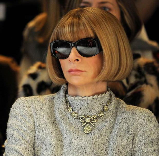 Anna Wintour at a fashion show, wearing her trademark sunglasses. Photo: Getty Images