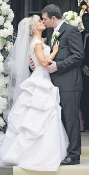 Newlyweds Sean Quinn Jnr and Karen Woods share a kiss after the ceremony