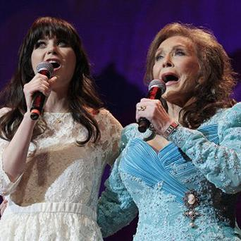 Zooey Deschanel joined Loretta Lynn onstage at the Grand Ole Opry