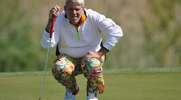 John Daly of USA lines up a putt during the third round of the Sicilian Open at Verdura Golf and Spa Resort on March 31, 2012 in Sciacca, Italy.