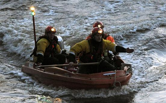 Police divers search the area where a boat capsized near Barford on the River Avon