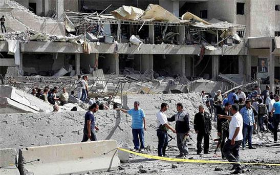 Two large explosions killed 40 people in Damascus on Thursday, state media said, destroying dozens of cars on a highway and damaging an intelligence complex involved in President Bashar al-Assad's crackdown on a 14-month-old uprising. Photo: Reuters