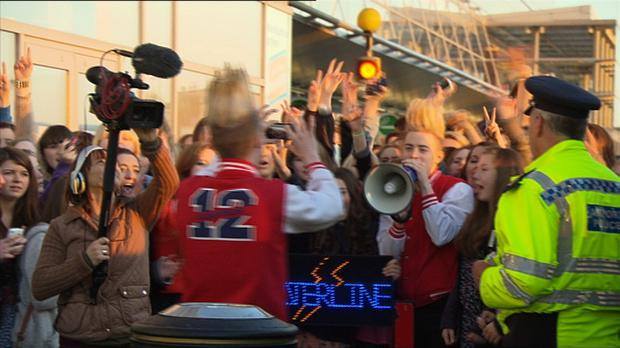 Jedward are greeted by fans at the airport in Baku.