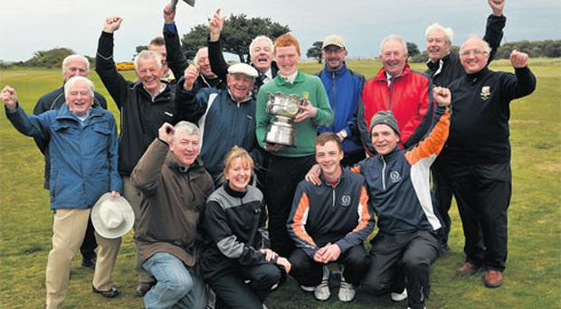 Gavin Moynihan, of The Island, with his fellow club members after winning the 2012 Irish Amateur Open Championship at Royal Dublin Golf Club yesterday