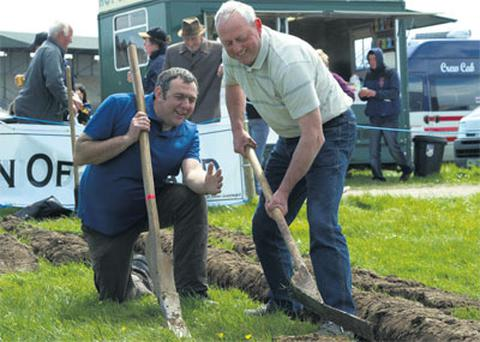 Jon Rule and Tom Kennedy demonstrating the art of loy digging at the Kingdom County Fair, Tralee, Co Kerry, yesterday.