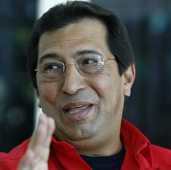There have been claims a plot to kill Hugo Chavez's brother Adan Chavez were hidden in a crossword puzzlet (AP/ Javier Galeano)