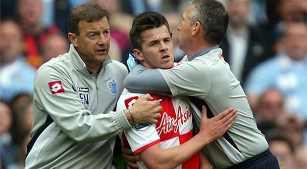 Joey Barton is dragged from the pitch by QPR's coaching staff
