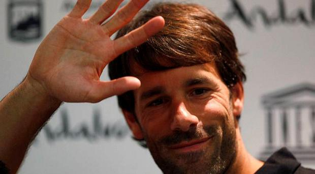 Malaga's Ruud van Nistelrooy of The Netherlands waves at the end of his news conference after announcing his retirement. Photo: Reuters