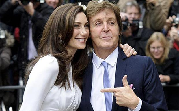 The wealth of Nancy Shevell, pictured with Sir Paul McCartney on their wedding day, bumped the Beatle up the rich list. Photo: AP