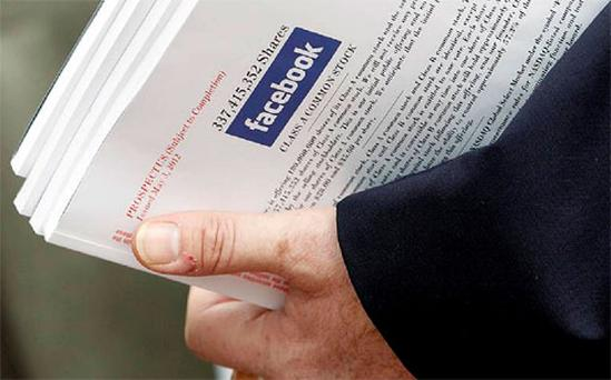 An investor holds prospectus explaining the Facebook stock after attending a show for Facebook Inc's initial public offering at the Four Season's Hotel in Boston, Massachusett. Photo: Reuters