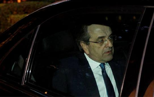 Greek conservative party leader Antonis Samaras leaves the presidential palace after a meeting in Athens. Photo: Reuters