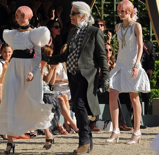 Karl Lagerfeld (C) and models at the Chanel 2012/13 Cruise Collection at Chateau de Versailles on May 14, 2012 in Versailles, France.
