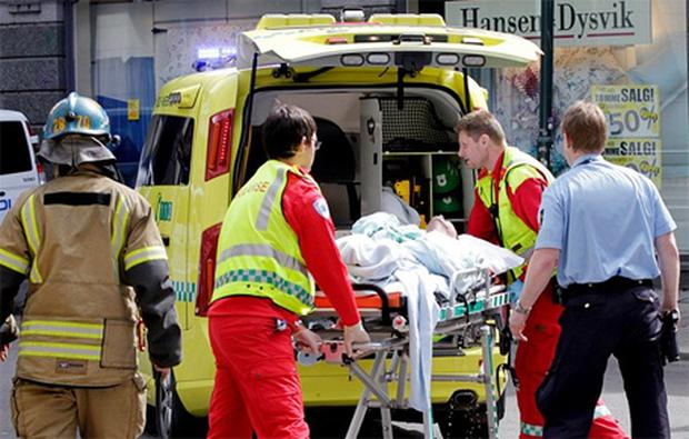 The man was conscious and groaning as he was taken away on a stretcher