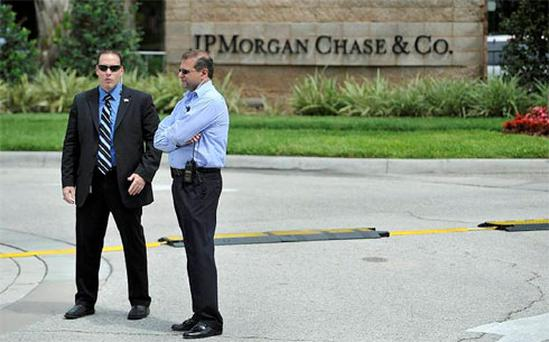 Security guards stand watch outside the JP Morgan Chase & Co annual shareholders meeting at the bank's back-office complex in Tampa, Florida. Photo: Reuters