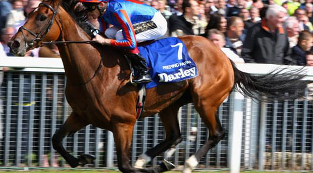 Johnny Murtagh rides Peeping Fawn to victory in The Darley Yorkshire Oaks August 22, 2007 in York, England. Photo: Getty Images